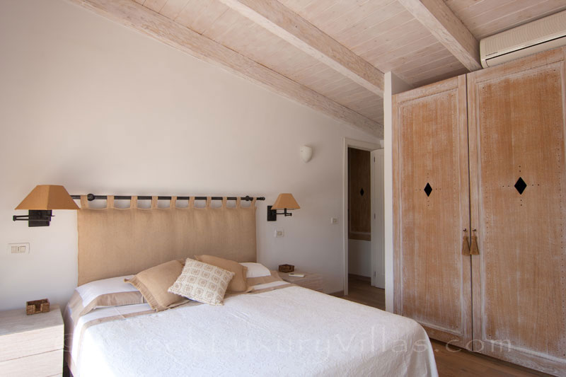 A bedroom with seaview in the luxury villa with a pool in Paxos