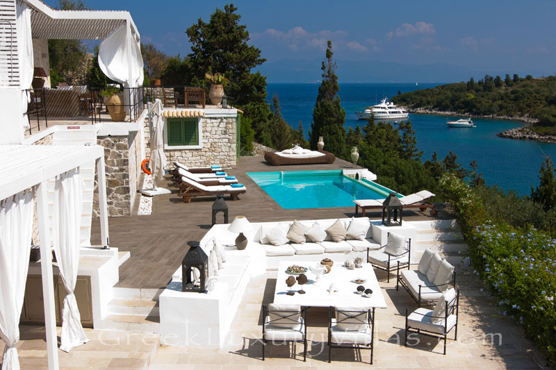 A seafront luxury villa with a boat mooring in Paxos