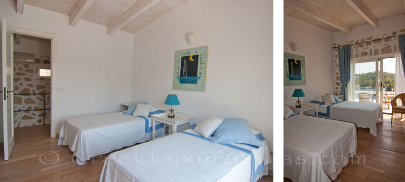 Bedroom with seaview in a luxury villa with a pool in Paxos
