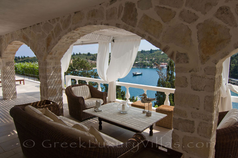 Boat mooring at a seafront luxury villa with a pool in Paxos
