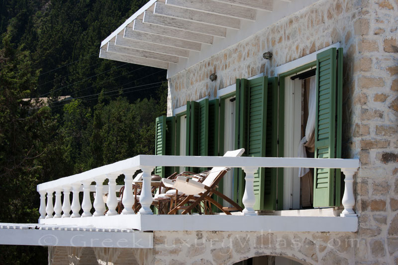 A balcony with seaview in a waterfront luxury villa in Paxos