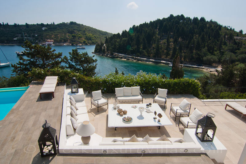A waterfront luxury villa with a boat jetty in Paxos