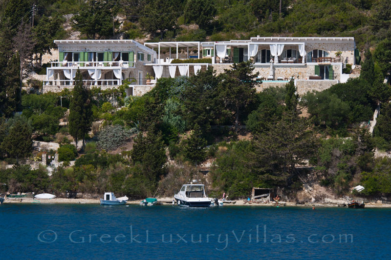 A waterfront luxury villa with a boat mooring in Paxos