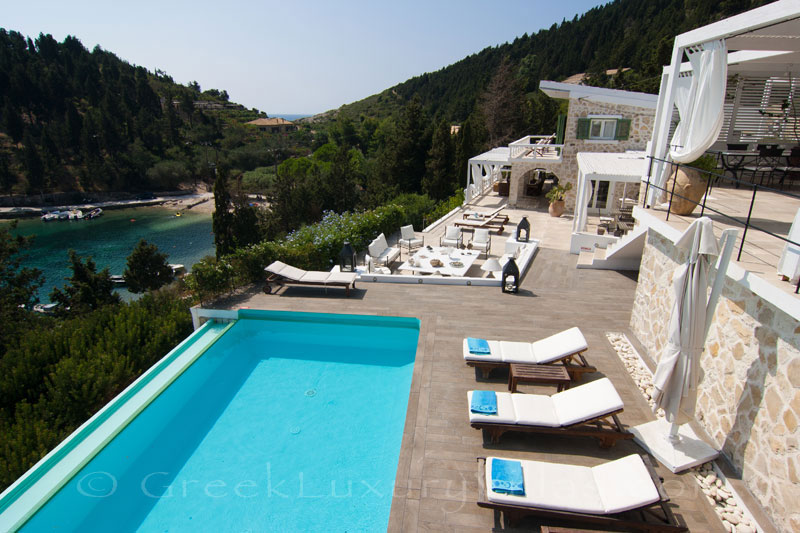 A seafront luxury villa with a boat parking in Paxos