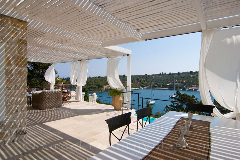 Dining area for big groups in a seafront luxury villa in Paxos