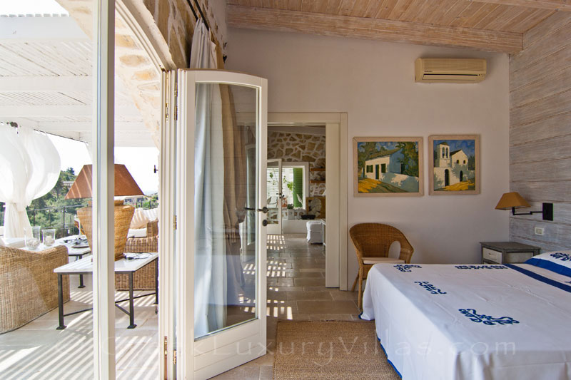 A bedroom with seaview in a seafront luxury villa in Paxos