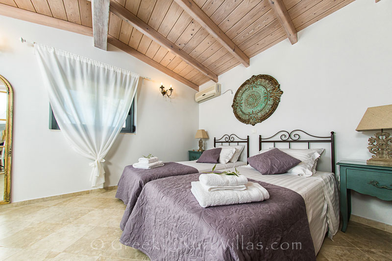 A bedroom in a seafront villa in Mongonisi, Paxos