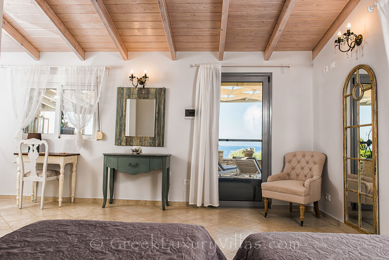A bedroom with seaview in a seafront villa in Paxos