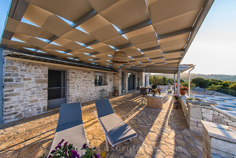 A sunny veranda in a seafront villa in Mongonisi, Paxos