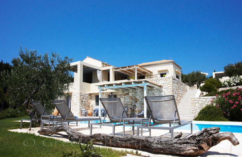 A beachfront villa with a pool in Paxos