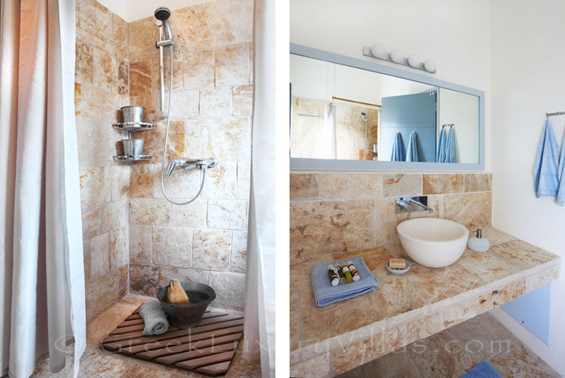 The bathroom in a beachfront villa with a pool in Paxos