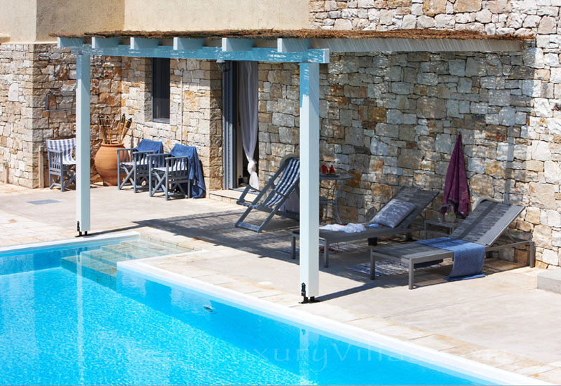 Pool area with seaview at a beachfront villa in Paxos