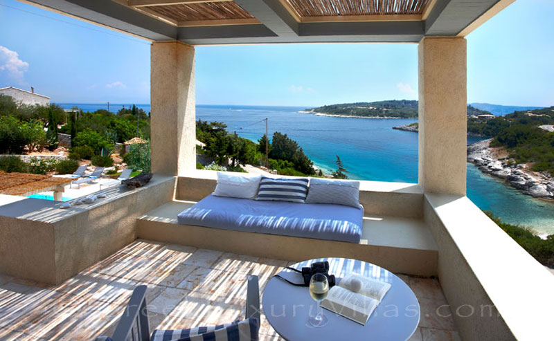 The view of the sea from a beachfront villa with a pool in Paxos
