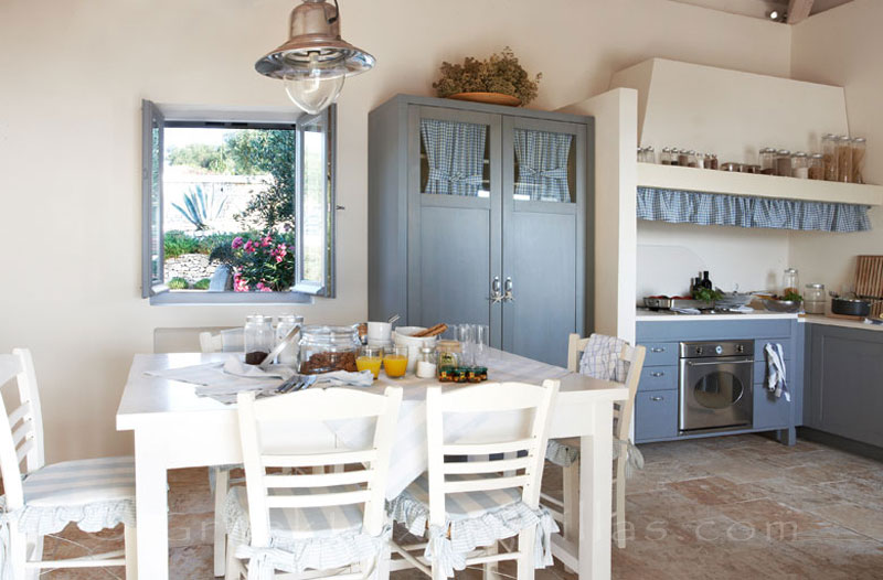 The kitchen and the dining area of a beachfront villa with a pool in Paxos