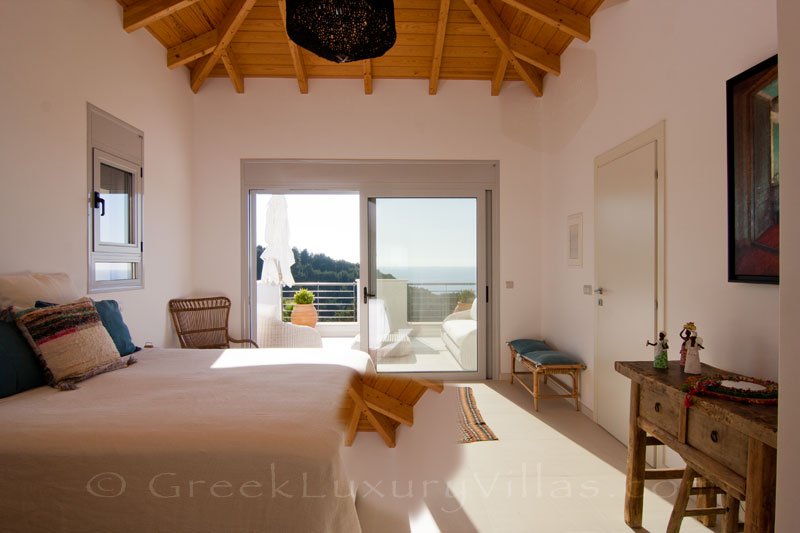 Bedroom with seaview in a modern luxury villa with a pool in Paxos