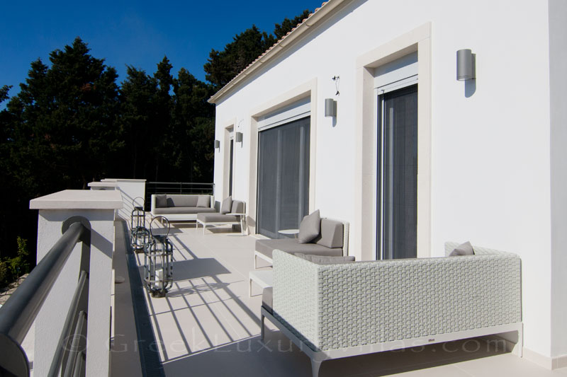 The balcony of the bedroom with seaview of a modern luxury villa with a pool in Paxos