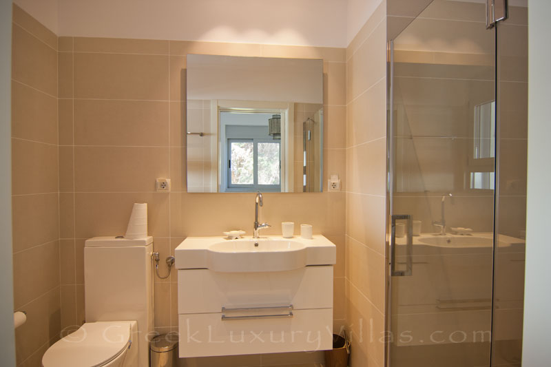 The bathroom of the guest house of a modern luxury villa with a pool in Paxos