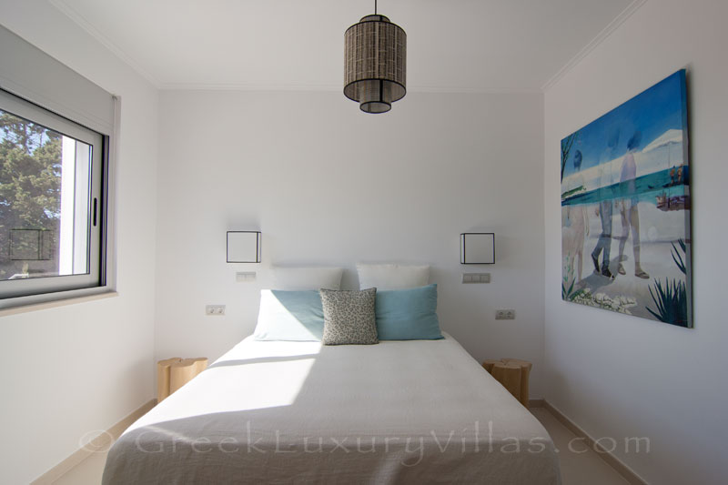 The bedroom of the guest house of a modern luxury villa with a pool in Paxos