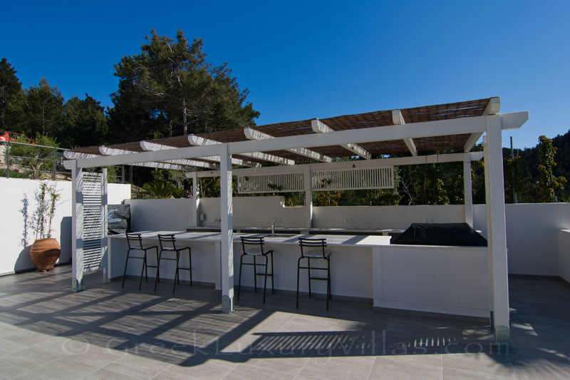 The pool bar of a modern luxury villa with seaview in Paxos