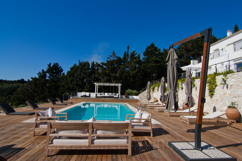 A big pool area with seaview in a modern luxury villa in Paxos