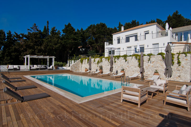 A modern luxury villa with a big pool area with seaview in Paxos