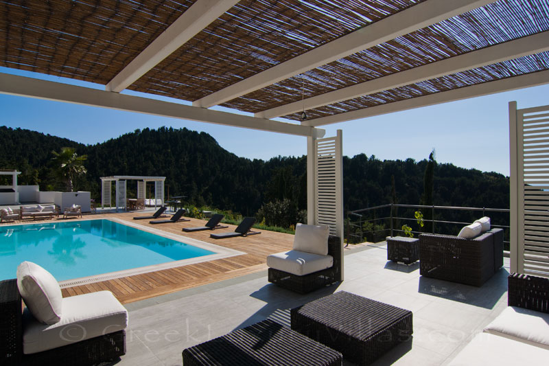 The lounge of the pool bar area of a modern luxury villa in Paxos with seaview