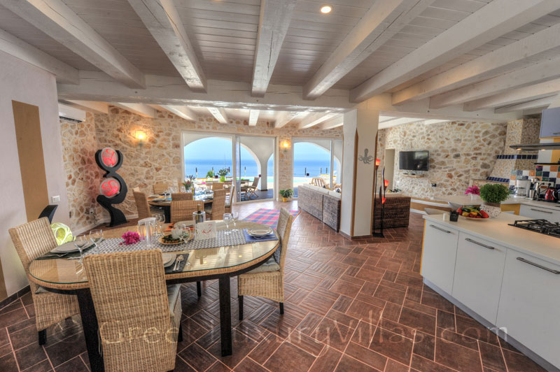 The living-room of the cheerfully decorated villa with a pool and seaview in Paxos