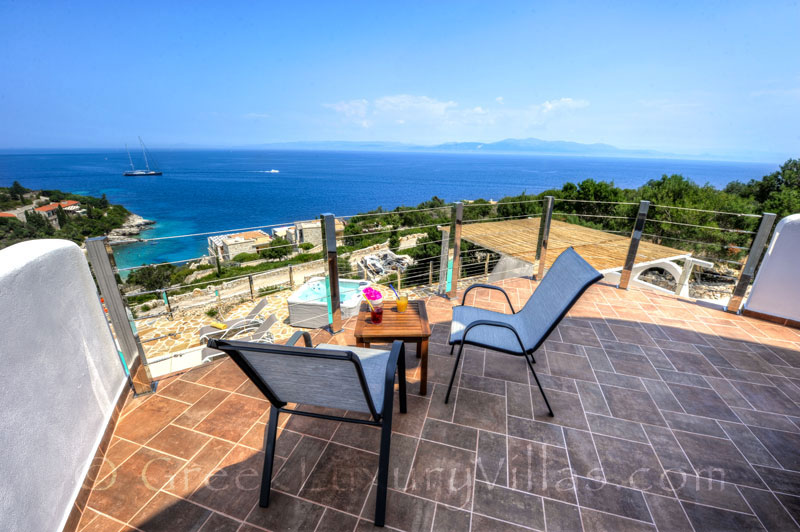 The balcony of a villa with a pool and seaview in Paxos