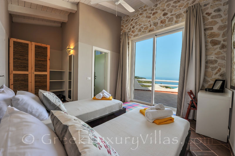 A bedroom of the villa with a pool and seaview in Paxos
