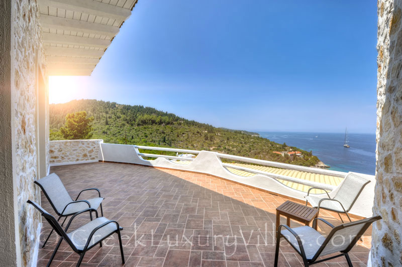 A balcony of the villa with a pool and seaview in Paxos