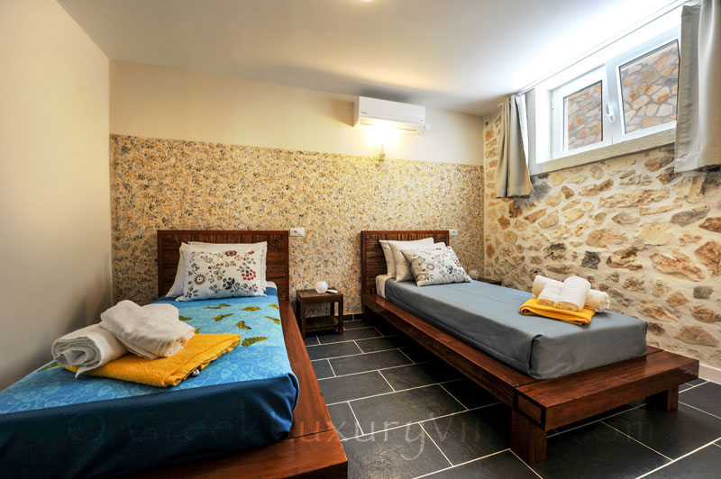 A bedroom with seaview in a cheerfully decorated villa with a pool in Paxos