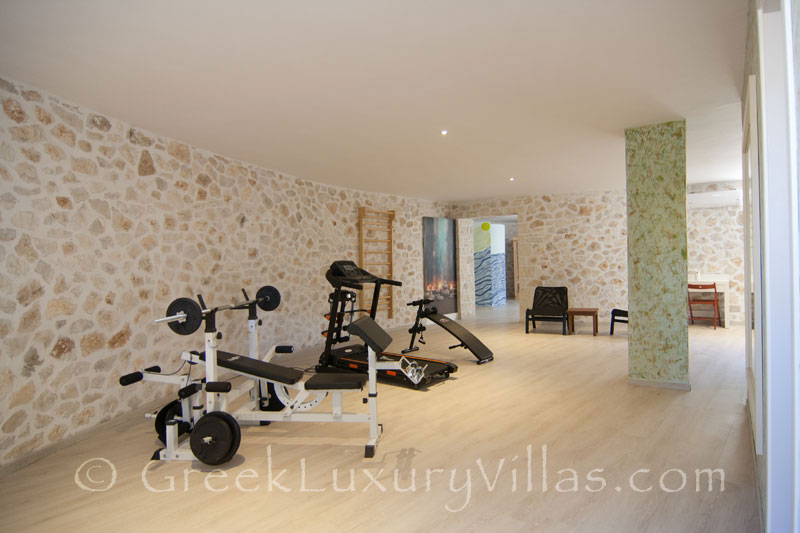 The gym and sauna of a luxury villa with a pool in Paxos