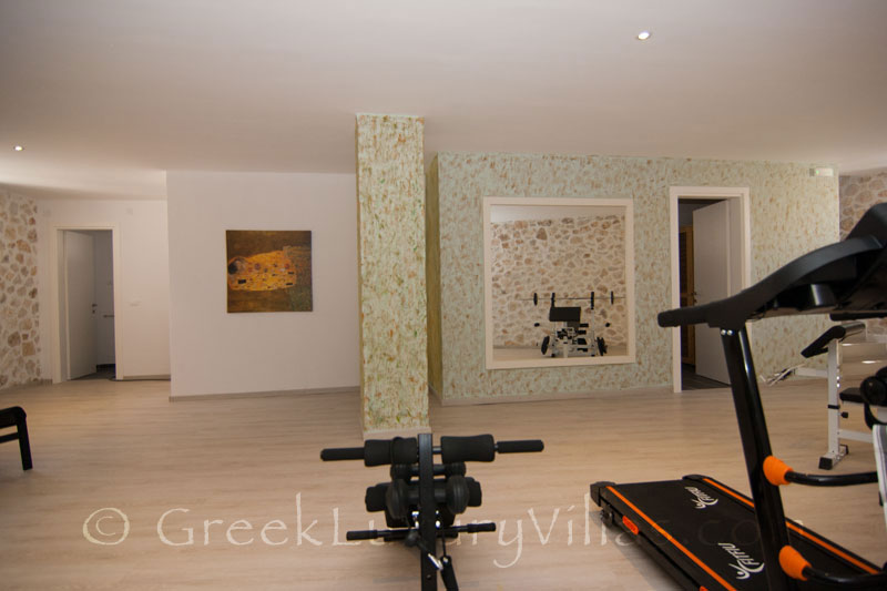 The gym and sauna in a luxury villa with a pool in Paxos