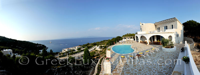 Panoramic sea view of a villa with a pool in Paxos