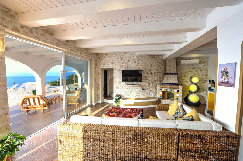 The living-room of a cheerfully decorated villa with a pool and seaview in Paxos