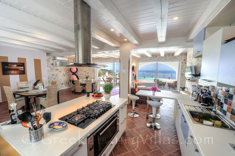 The kitchen of a cheerfully decorated villa with a pool and seaview in Paxos