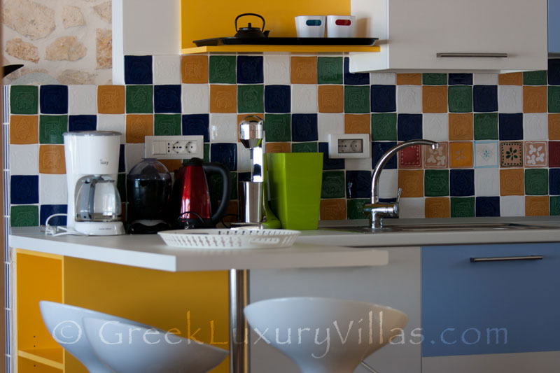 The kitchen in a cheerfully decorated villa with a pool and seaview in Paxos