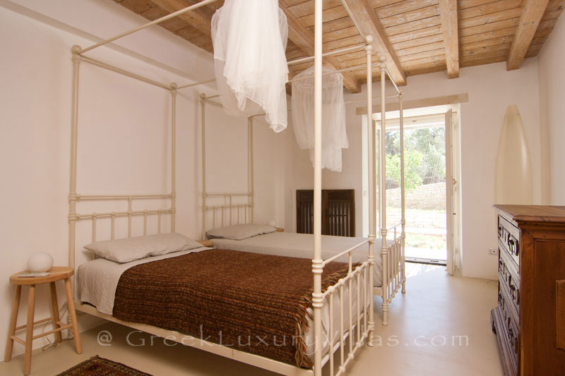 A bedroom of the hiltop estate in Paxos