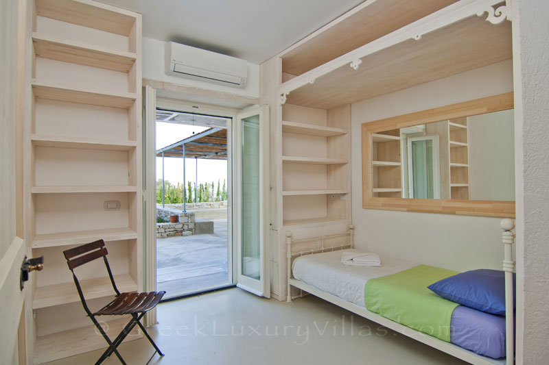 A single bedroom in the guest house of a hiltop estate in Paxos