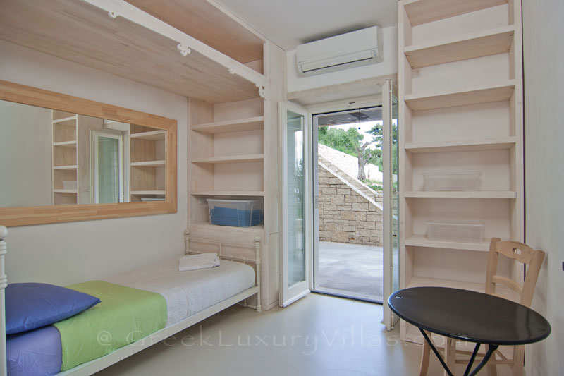 The single-bedroom of the guesthouse in a hiltop estate in Paxos