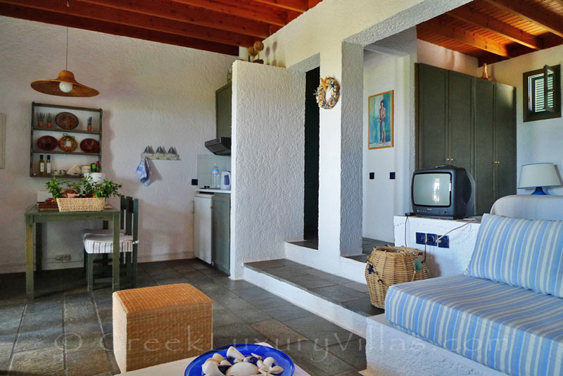 An open plan bedroom in the beach bungalows in Peloponnese