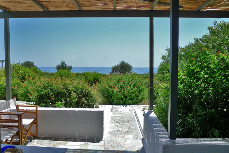 Verandah of beach bungalows in Peloponnese overlooking the sea
