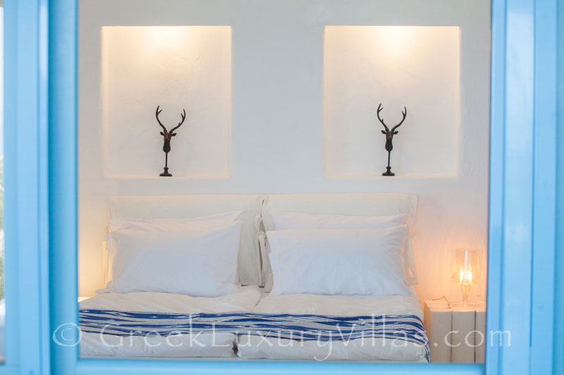 A bedroom in a luxury villa with a pool in Rhodos