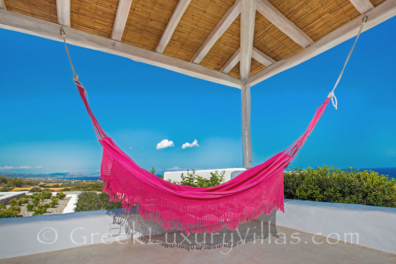 A hammock in a luxury villa with a pool in Rhodes