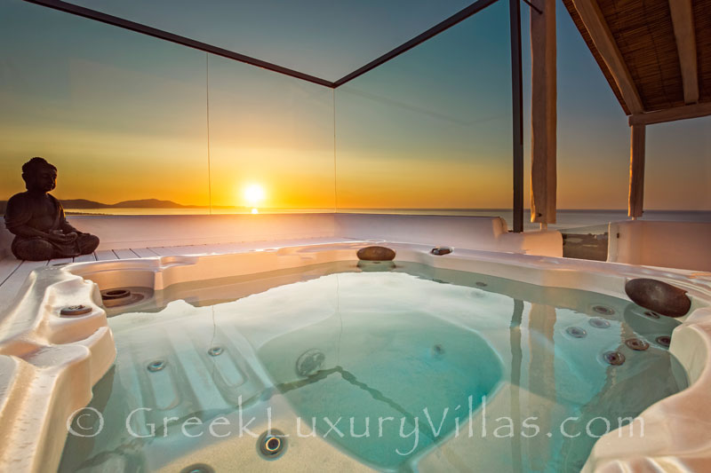 Sunset from the outdoor jacuzzi of a luxury villa in Rhodos