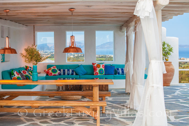 Outdoor dining area in a luxury villa with a pool in Rhodos