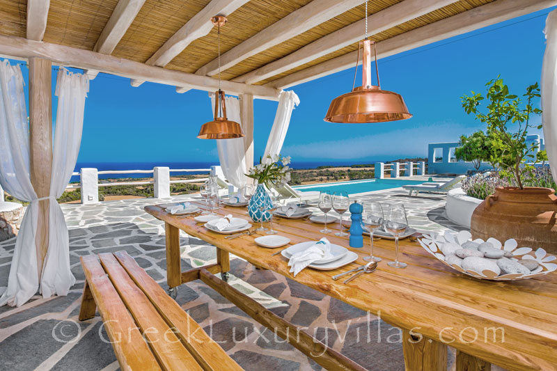 Dining area with a pergola in a luxury villa with a pool in Rhodes