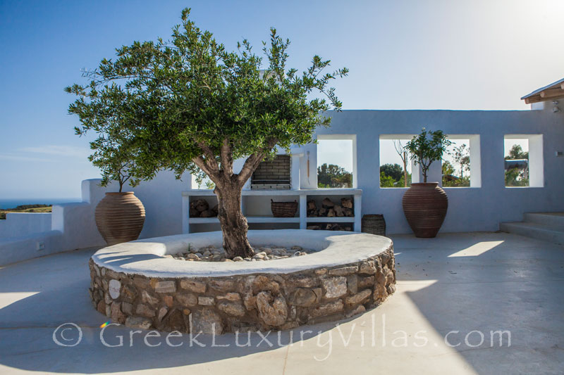 The bbq area of a luxury villa with a pool in Rhodes