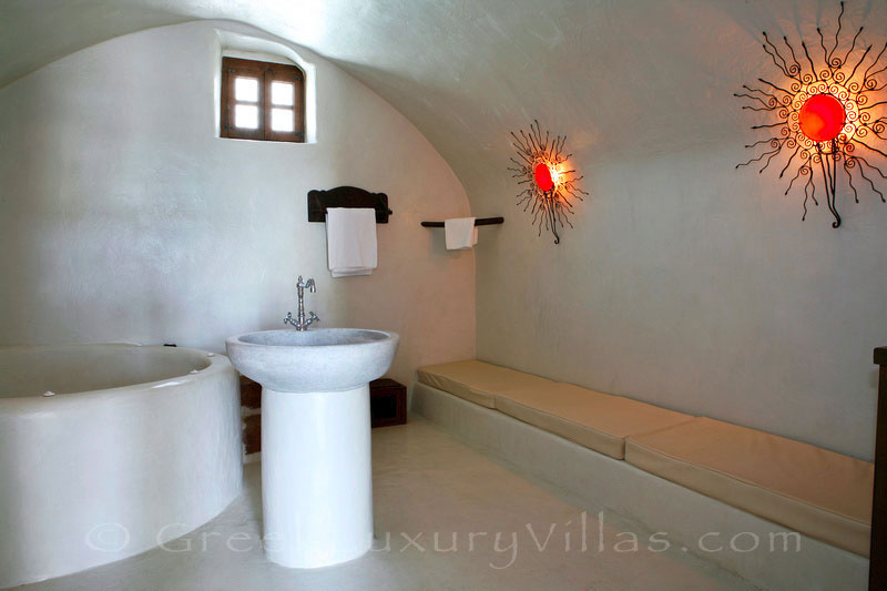 A luxurious bathroom in a villa with a pool in a traditional village in Santorinii