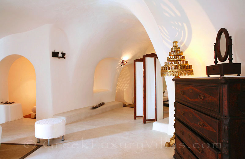 The cave style living-room of a luxurious villa in a traditional village in Santorini